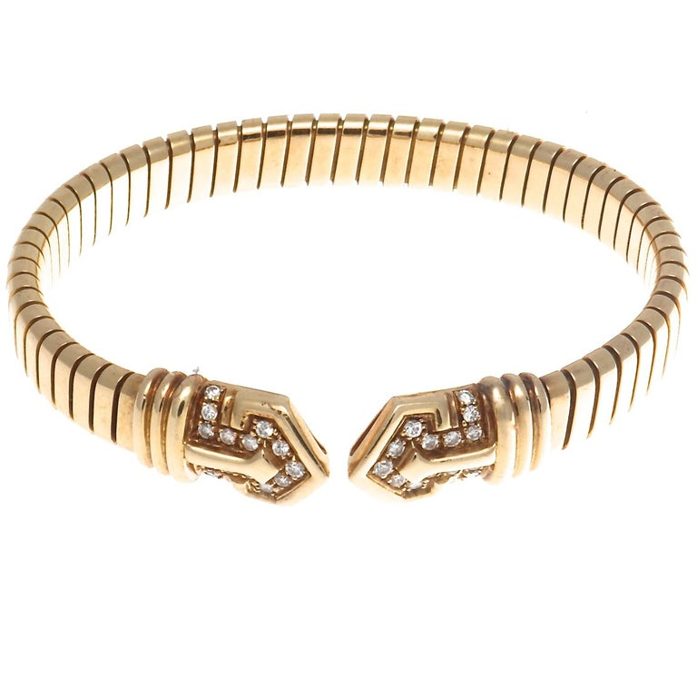 There are 30 round brilliant diamonds in this fabulous Bulgari Tubogas 18k gold bracelet, that weigh approximately 0.45 carats and are graded as E,F color VS clarity. Signed Bvlgari and stamped with makers mark. Circa 1960's. Measures 2 1/4 inches X