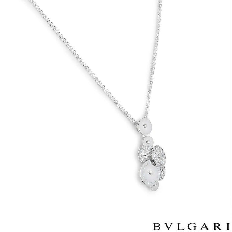 An 18k white gold pendant from the Bvlgari Cicladi collection. The pendant is composed of a cluster of 7 circular spinning discs, each alternating in size. The largest of the discs is engraved with the Bvlgari Bvlgari logo and three of the discs are