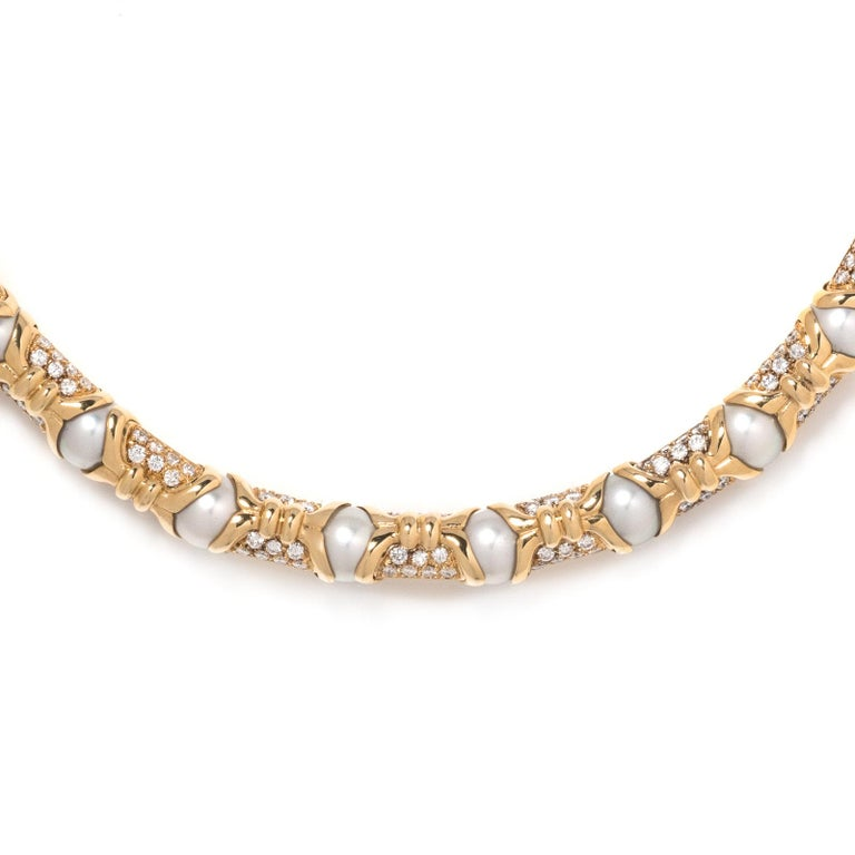 In a semi-flexible link design, containing 26 cultured pearls and numerous round brilliant cut diamonds weighing approximately 7.50 carats total. 16 inches long. 107 Grams Stamp: BVLGARI 750 (Italian hallmark) Accompanied by a Bvlgari inner fold and