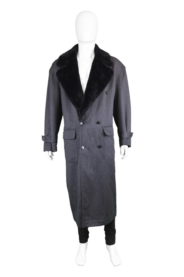 Byblos Men's Vintage Fine Grey Wool Over Coat Jacket with Black Faux Fur Collar, 1990s   Size: Marked 50 which is roughly a men's M-L but this gives an oversized fit and would better suit a Men's XL to XXL which still gives a loose fit that is meant