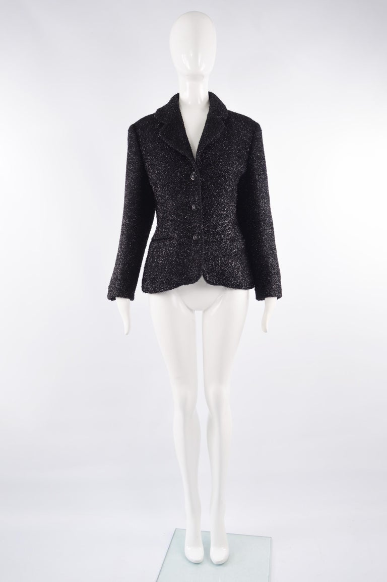 A fabulous vintage Byblos jacket from the 80s in a black and silver fuzzy fabric. With single breasted buttons and a flattering yet simple cut that lets the fabric speak for itself and allow for a versatile look. Perfect paired with jeans  or a