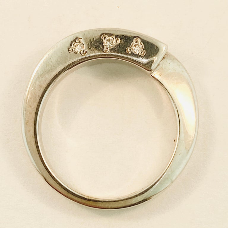 Modern French Bypass Diamond Ring in 18 Karat White Gold Ring W Three Stones on Top For Sale