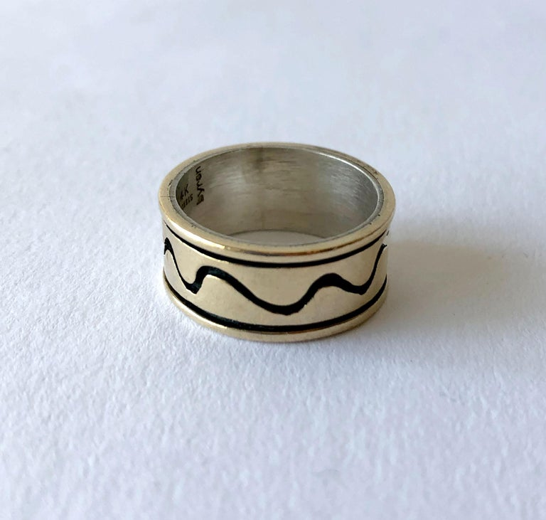 Sterling silver and 14k gold ring with squiggle design created by Byron Wilson of   Ring is a finger size 8 and is 3/8