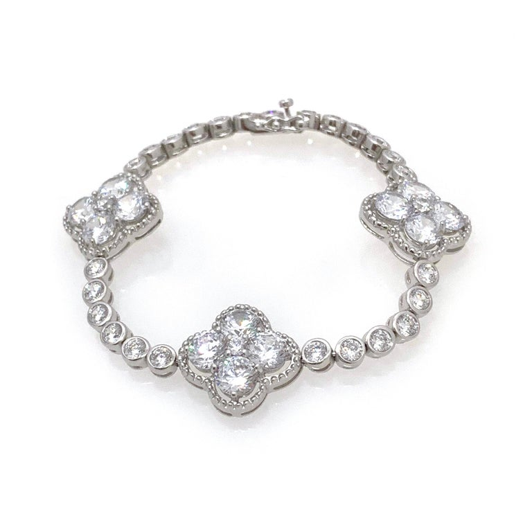 Byzantine Clover Sterling Silver Station Bracelet  This beautiful bracelet features 3 byzantine clover with trimming design encrusted with round faux diamond cubic zirconia, round bezel set faux diamonds, hand set and interconnected piece by piece,