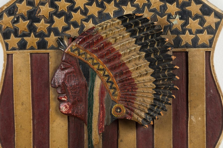 Carved and painted Native American 41 star patriotic shield, circa 1890s. Original paint surface. On November 2, 1889, North and South Dakota became the 39th and 40th states admitted to the Union. Six days later on November 8, 1889, Montana became