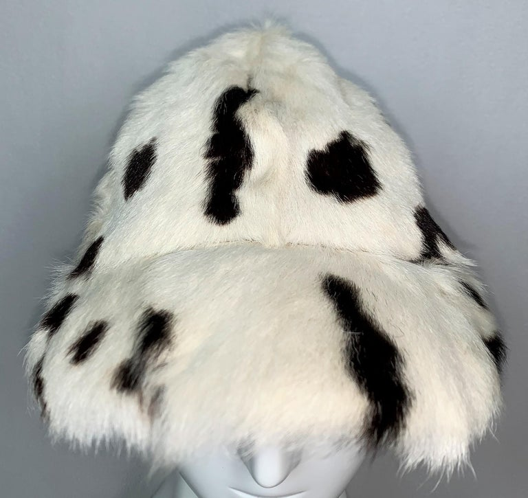 DESIGNER: Circa 2001 Christian Dior by John Galliano  Please contact us for more images or information  CONDITION: Good- no flaws  FABRIC: Goat Fur  COUNTRY: France  SIZE: U  MEASUREMENTS; provided as a courtesy only- not a guarantee of fit:   1st