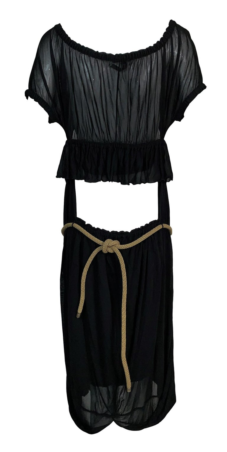 DESIGNER: Circa 2003 Yves Saint Laurent by Tom Ford- Can be worn several waist depending on how much skin you want to show.   Please contact for more information and/or photos.  CONDITION: Good  FABRIC: 100% rayon  COUNTRY MADE: Italy  SIZE: