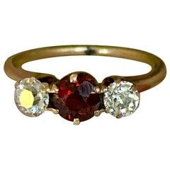 C. D. Peacock Garnet and Diamond 14 Karat Gold Ring