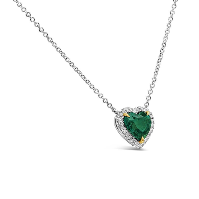 A rare piece of jewelry showcasing a 1.68 carat vivid color green emerald in a heart shape, surrounded by a single row of round brilliant diamonds set in platinum.  Pendant is suspended on an 18 inch 18k white gold chain. Center emerald is certified