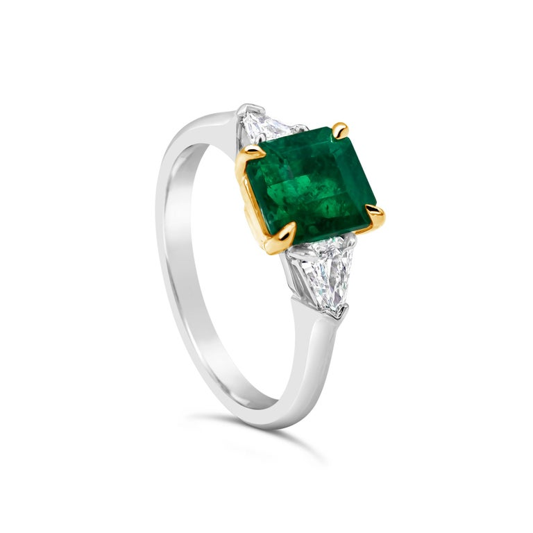Features a color-rich 1.48 carat Colombian emerald that C. Dunaigre certified as vivid green color, with minor treatment. The emerald is flanked by two bullet shape diamonds in a polished platinum mounting.  Style available in different price