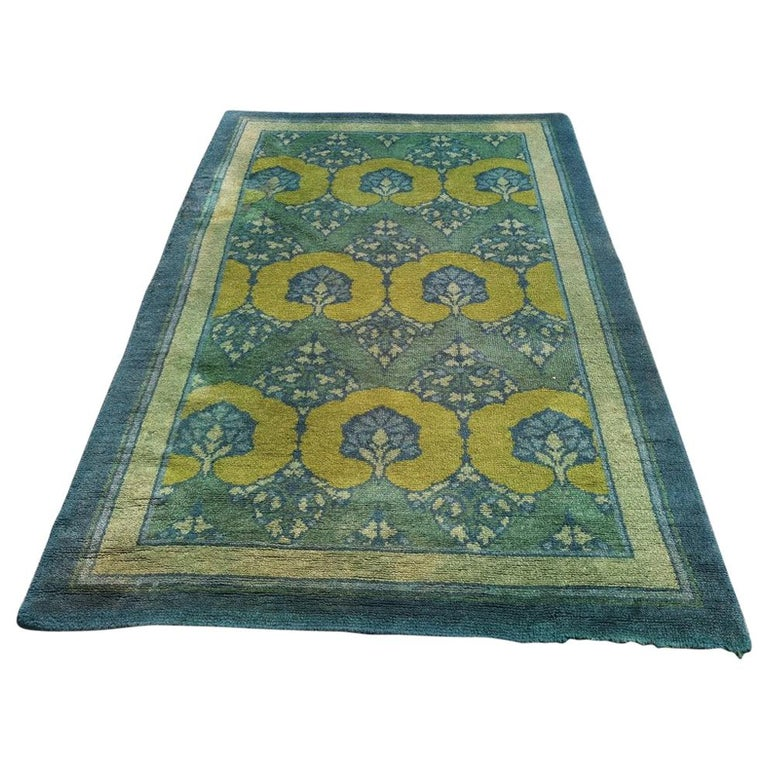 C F A Voysey for Liberty & Co. a Rare 'Glenmure' Donegal Rug with Rich Colors For Sale