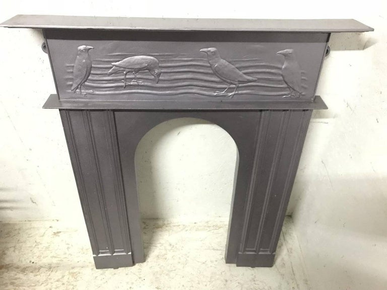 C.F.A Voysey, probably made by George Wright. A rare cast iron fireplace with feeding character crows dining in a field, reminiscent of gentleman in tails. The fireplace has been professionally painted silver at some point which I was happy to