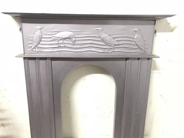 Arts and Crafts CFA Voysey, Attributed to George Wright a Cast Iron Fireplace with Feeding Crows For Sale