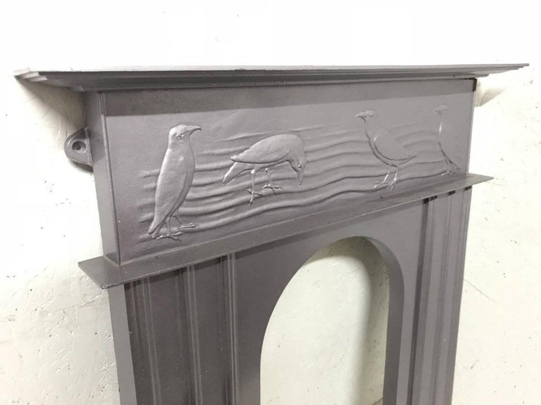 English CFA Voysey, Attributed to George Wright a Cast Iron Fireplace with Feeding Crows For Sale
