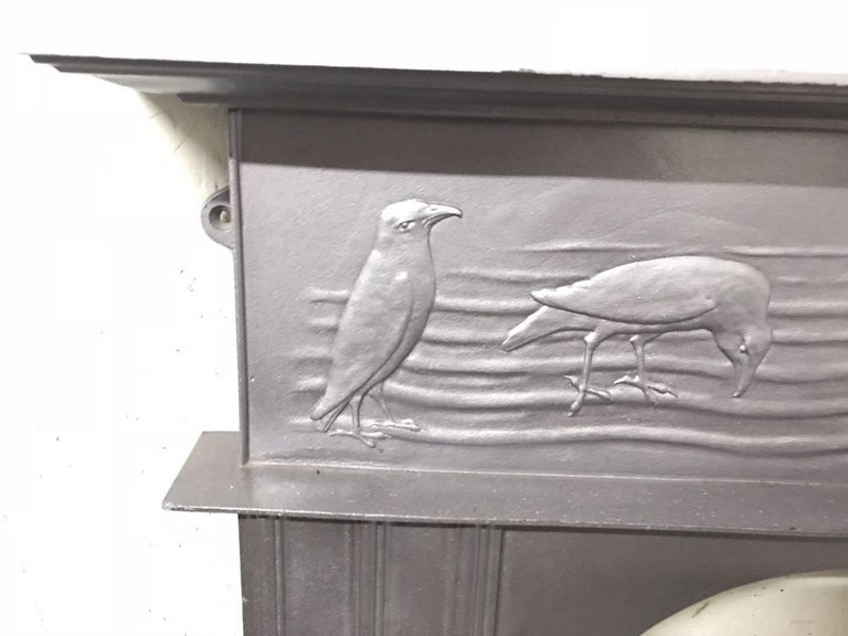 CFA Voysey, Attributed to George Wright a Cast Iron Fireplace with Feeding Crows In Good Condition For Sale In London, GB