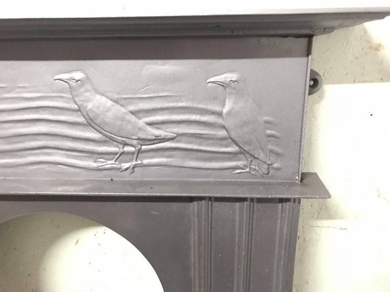 Early 20th Century CFA Voysey, Attributed to George Wright a Cast Iron Fireplace with Feeding Crows For Sale