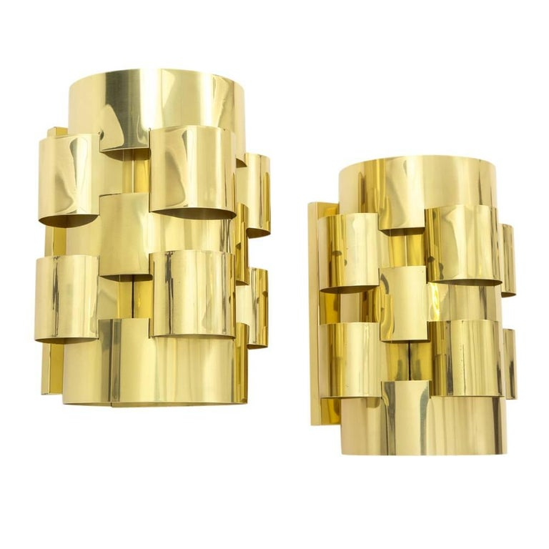 C. Jere sconces, brass clouds, signed. Pair of medium scale cloud form sconces in polished and lacquered brass with rectangular wall mounts. One of the sconces is signed