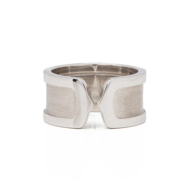 This Ring by Cartier is from their C De Cartier collection and features a double C design made in 18k White Gold.  The Ring sizes are EU 57  and US 8. The band width is 1cm. The total weight is 13.6 grams.  ABOUT THE COLLECTION A signature C bestows