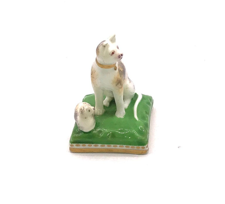 Cats are more rarely seen in porcelain than dogs, this porcelain Chamberlain Worcester cat and her kitten, circa 1810, are seated on a square base., 1.5 inches long and 2 inches high. Robert Chamberlain opened his shop in 1791 and from that point