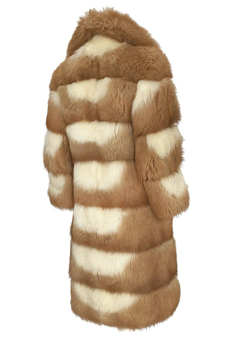 I have held this in my archives for several years now and I think that it is a stunning example of the fur pieces being produced at this point in Christian Dior's history. I am no expert on furs but believe this it is some type of a sheepskin that