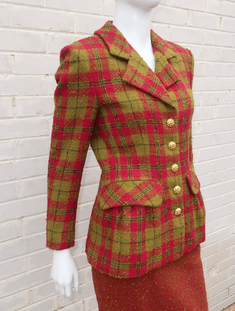 Ladylike and refined are characteristics of Adolfo clothing from the 1970s-1980s.  This raspberry red and olive green plaid boucle skirt suit fits that description with the added whimsical bonus of pouf pleated pockets at the hip line of the jacket.