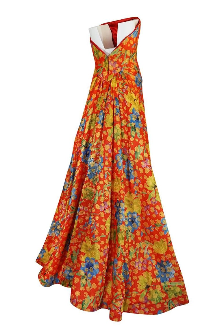 The designer of this dress, Sully Bonnelly, had a bit of a hey day in the late 1990s. He worked as a designer for the houses of Bill Blass and Eli Tahari before launching his own collection in 1998. It retailed at Saks Fifth Avenue, Neiman Marcus,