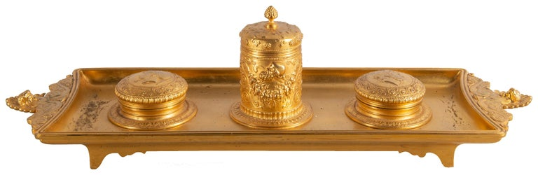 A good quality late 19th century French gilded Ormolu Gran Tour influenced gilded Ormolu ink well, having classing motifs and Roman Centurion bust embossed to the lids. Stamped, Barbedienne.