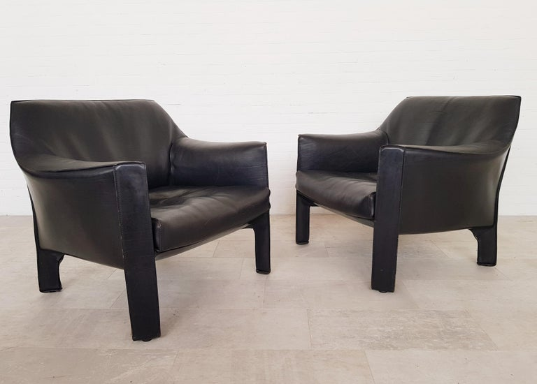 Cassina CAB 415 lounge chairs by Mario Bellini for Cassina, 1980s  The CAB chair has an enamelled steel frame, the very strong black buffalo leather upholstery is zippered over the frame.