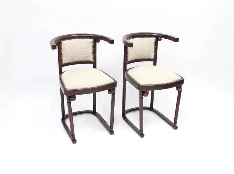 These two chairs were designed by Josef Hoffmann in 1907 for the famous Cabaret Fledermaus in Vienna and these examples were produced by Thonet in 1920-1930s. They are made from bentwood with a new fabric upholstered seat.