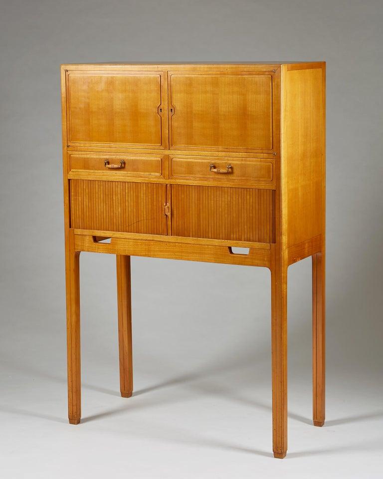 Elmwood, with Oregon pine interiors, and brass.  Measures: H 131 cm/ 4' 3 1/2'' W 85 cm/ 33 1/2'' D 40 cm/ 15 3/4''.
