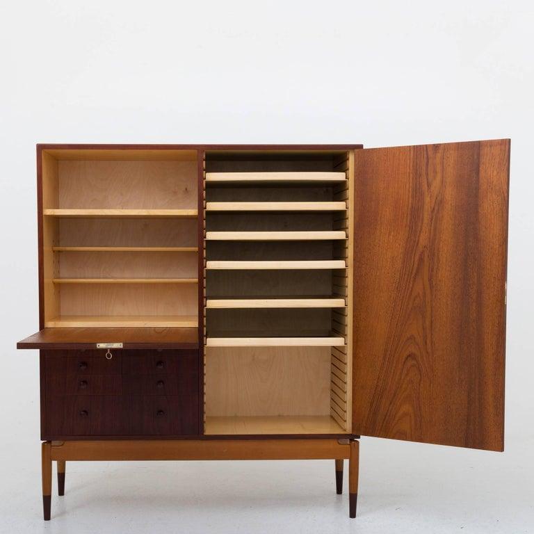 Tall cabinet in teak and beech. Maker Søren Willadsen, Vejen.