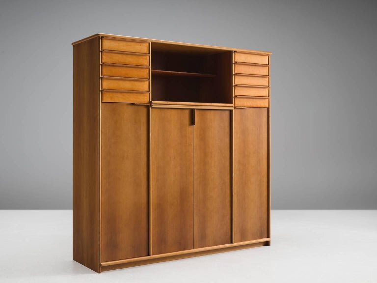 Cabinet, leather, walnut, Italy, 1950s.  This well-executed and detailed cabinet is made out of walnut and cognac leather. It features four doors, three shelves and fives drawers on each side of the cabinet. In the middle between the two units of