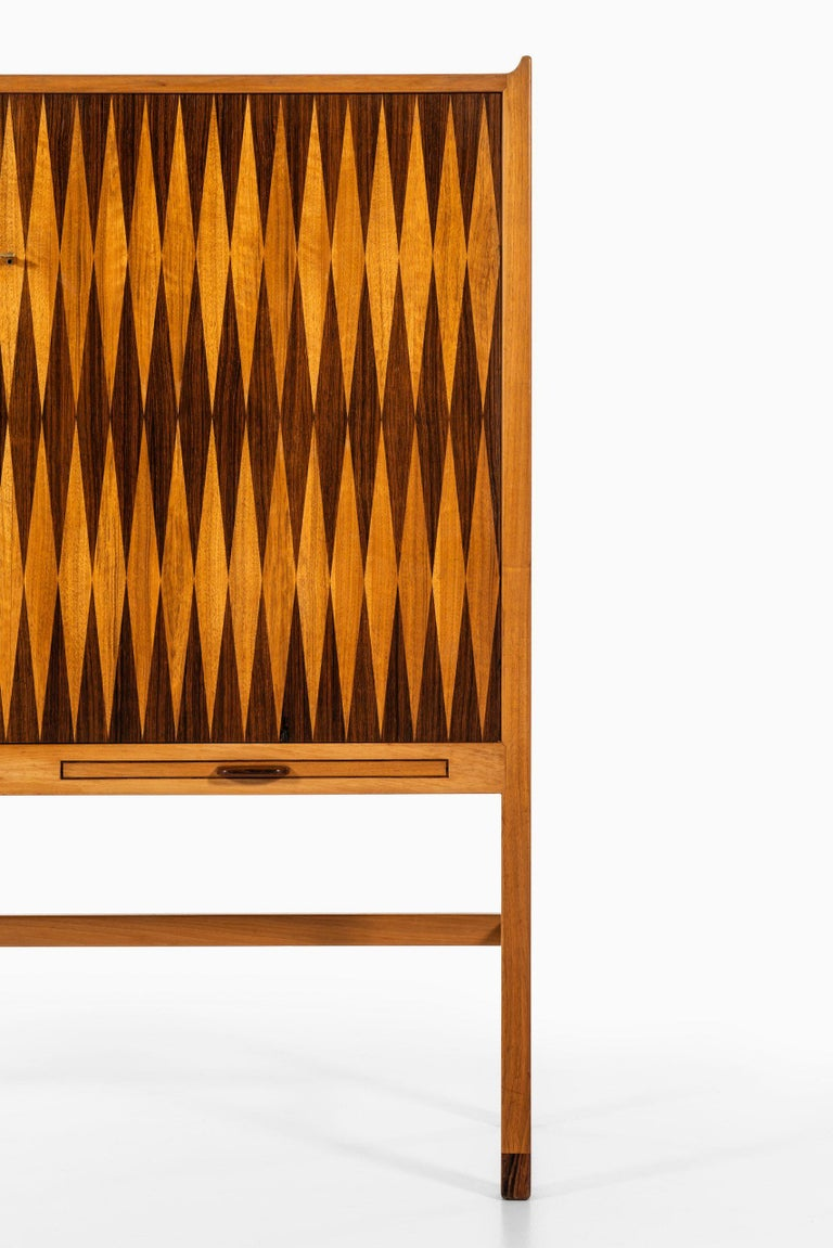 Rare cabinet with backgammon style inlays by unknown designer. Probably produced in Denmark.