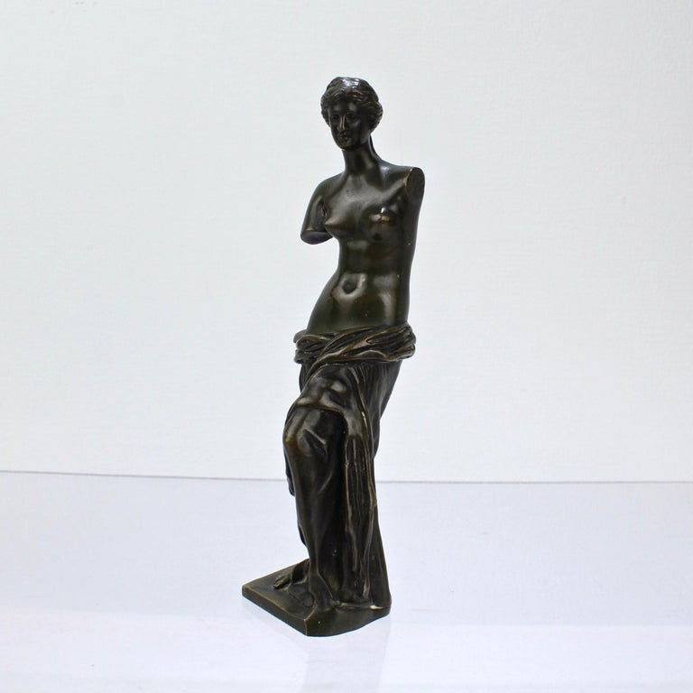 A fine Venus de Milo bronze after Sauvage.  In an diminutive size that is perfect for the desk, mantel or vitrine.   Simply a wonderful little bronze in the Grand Tour or Kunstkammer traditions of objet.  Measures: Height: ca. 6 3/8