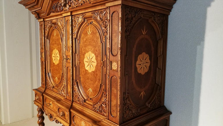 German Cabinet with Hinged Doors and Wonderful Ornamentations For Sale