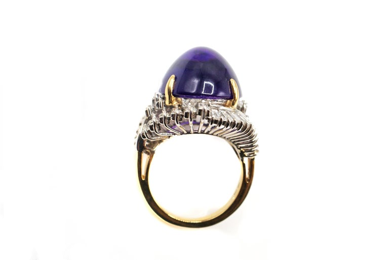A gorgeous rich deep purple Amethyst cabochon has been chosen for the center piece of this stylish 1970s ring. Amethysts with this strong color saturation are usually found in Siberia and are quite rare these days. The perfect cut of this oval