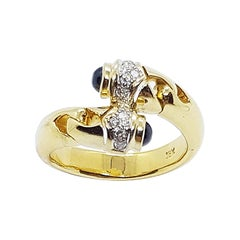 Cabochon Blue Sapphire with Diamond Ring Set in 18 Karat Gold Settings