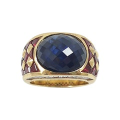 Cabochon Blue Sapphire with Ruby and Diamond Ring Set in 18 Karat Gold Settings