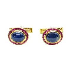 Cabochon Blue Sapphire with Ruby Cufflinks Set in 18 Karat Gold Settings