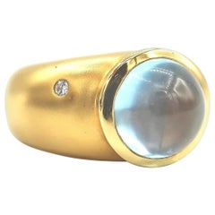 Cabochon Blue Topaz Step 18 Karat Yellow Gold Ring with a Diamond Speck on Side