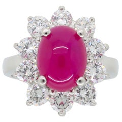 Cabochon Burma Ruby and Diamond Halo Ring in Platinum