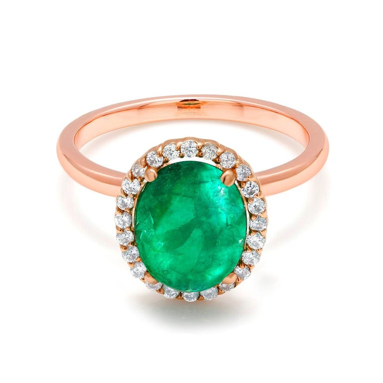 Fourteen Karat rose halo gold cocktail ring  Oval shape cabochon emerald weighing 2.40 carat Surrounded by pave set diamonds weighing 0.40 carat Ring size 6 In Stock New Ring Ring can be resized