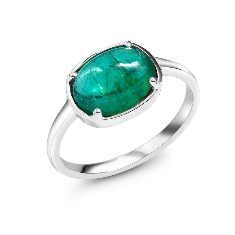 Eighteen karat white gold ring Cabochon emerald weighing 1.85 carat        Emerald measuring 9x7                                                                 Ring size 6 In Stock Ring can be resized  New Ring Handmade in USA Our design team