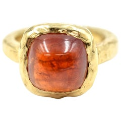 Cabochon Red Tourmaline 14 Karat Yellow Gold Hammered Ring