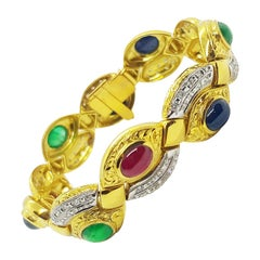 Cabochon Ruby, Emerald, Blue Sapphire with Diamond Bracelet in 18 Karat Gold
