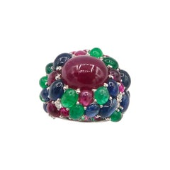 Clustered 39.39 Carat Cabochon Ruby Emerald Sapphire Diamond 18 Karat Gold Ring