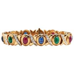 Armband aus 18 Karat Gelbgold mit Cabochon-Rubinen, Smaragden, Saphiren und Diamanten