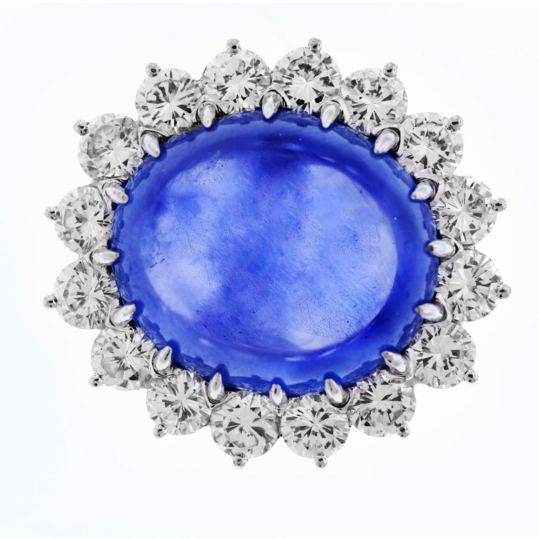 Platinum Ring with Top Quality Cabochon Sapphire center and Diamonds  This Cabochon Sapphire is truly top gem world class with truly remarkable color and clarity  Sapphire weights apprx. 25 carats and is an oval cut.  Sapphire is surrounded by