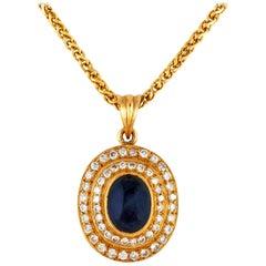 Caboshon Sapphire with Around Diamonds Pendant