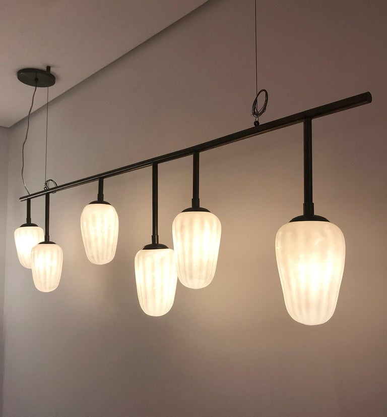 Cacau contemporary Brasilian Minimalist pendant light by Cristiana Bertolucci This poetic pendant was inspired by the fruit of Cacao, typical Brazilian fruit used for the manufacture of chocolate. This pendant is made of brass with an aged